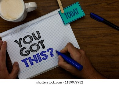 Writing note showing You Got This question. Business photo showcasing Believe that people will succeed in doing something Hand hold pen coffee cup blue pen paper clip stick on woody table.