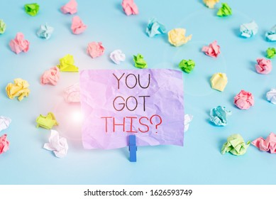 Writing note showing You Got This question. Business photo showcasing Believe that showing will succeed in doing something Colored crumpled papers empty reminder blue floor background clothespin.