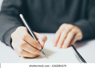 Writing on the blank notebook with copy space.