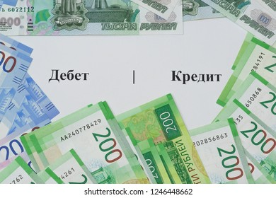 The writing on Russian language Debit and Credit and new Russian banknotes around. Accounting