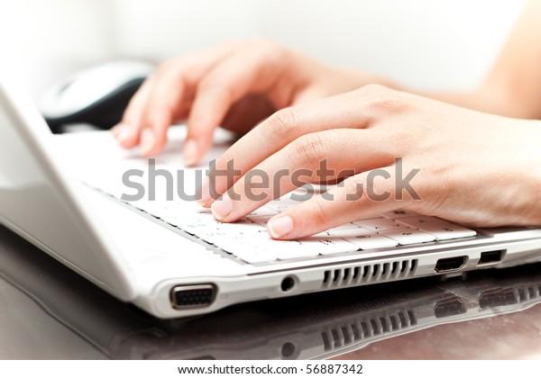 Writing on a white laptot