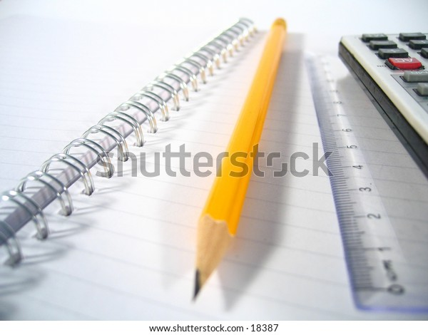 A writing pad with a ruler, a pencil and a calculator..