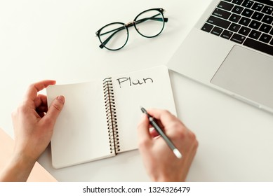 Writing a plan for business. Business concept - work in a bright modern office