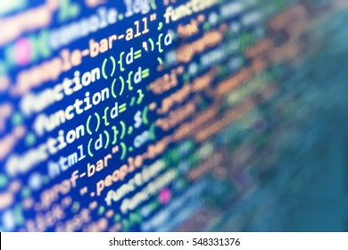 Writing programming functions on laptop. Website HTML Code on the Laptop Display Closeup Photo. Database bits access stream visualisation.