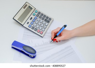 Writing of the report on work, leading of financial results. Verification of documents. The girl the secretary works with reports.
