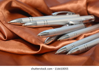 Writing silvers pen on the orange background