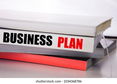 Writing text showing Business Plan. Business concept for Mission or Vision written on the book the white background.