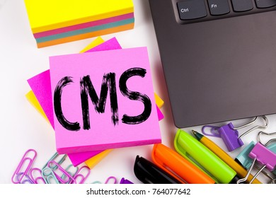 Writing text showing CMS made in the office with surroundings such as laptop, marker, pen. Business concept for CMS WWW Workshop white background with space