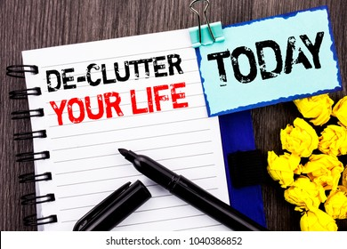 Writing text showing  De-Clutter Your Life. Business photo showcasing Free Less Chaos Fresh Clean Routine written notebook book paper the wooden background Today