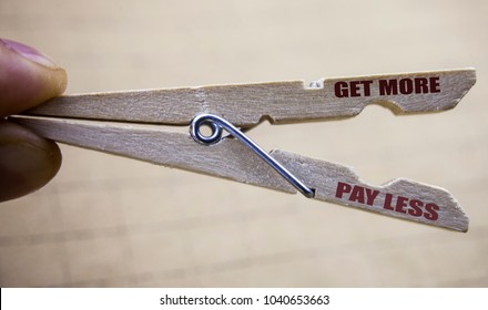 Writing text showing Get More Pay Less. Business concept for Budget Slogan Concept written on clip close up blurred background