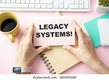 Writing text showing Legacy Systems. Business concept for Upgrade SOA Application written on sticky note paper on wooden background with pen, marker