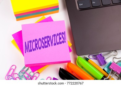 Writing text showing Microservices made in the office with surroundings such as laptop, marker, pen. Business concept for Micro Services Workshop white background copy space