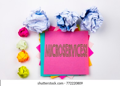 Writing text showing Microservices written on sticky note in office with screw paper balls. Business concept for Micro Services on the white isolated background.