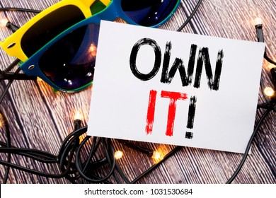 Writing text showing Own It Exclamation. Business concept for Ownership Control written on old wood wooden background with sunglasses