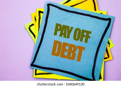 Writing text showing  Pay Off Debt. Business photo showcasing Reminder To Paying Owed Financial Credit Loan Bills written sticky note paper the pink background.
