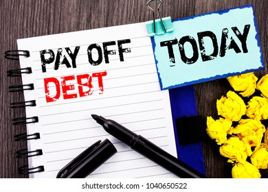Writing text showing  Pay Off Debt. Business photo showcasing Reminder To Paying Owed Financial Credit Loan Bills written notebook book paper the wooden background Today