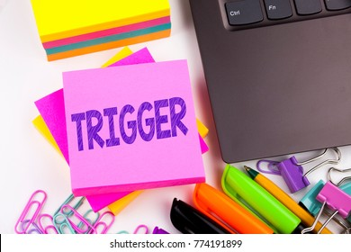 Writing text showing Trigger made in the office with surroundings such as laptop, marker, pen. Business concept for Stir Spark Loose or Unleash Idea Workshop white background space