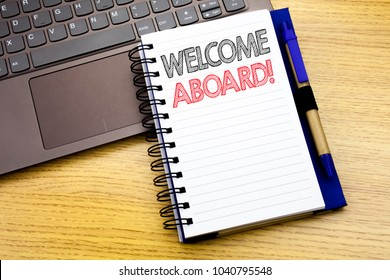 Writing text showing Welcome Aboard. Business concept for Greeting Join Member written on notebook book on wooden background in the Office with laptop