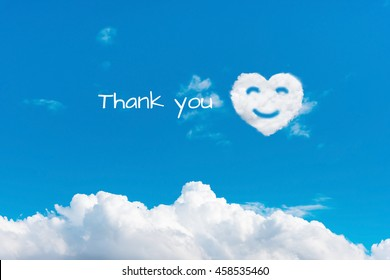 writing thank you on blue sky with clouds