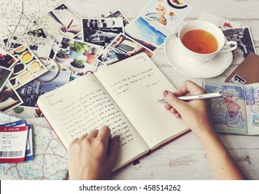 Writing Travel Diary Memories Photos Concept