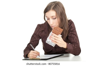 writing young woman with chocolate and clipboard