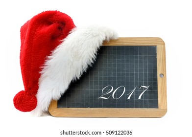 written 2017 on a slate with Christmas cap isolated on white