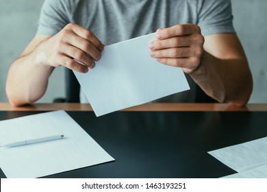 Written communication. Cropped shot of man folding blank mockup letter to send. Copy space.