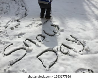 """""""Snow day"""" written in fresh snow."""