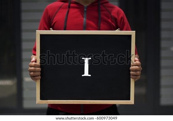 I written on blackboard with someone is holding it
