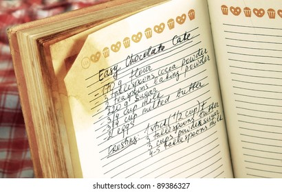 written recipe of easy chocolate cake in cookbook