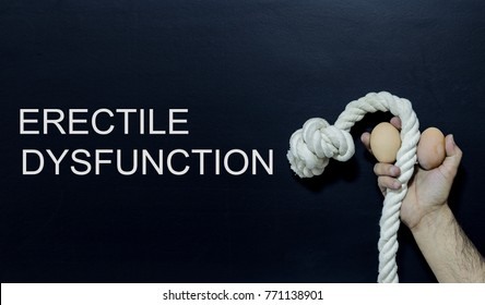 Written text: erectile dysfunction Man holding rope and two eggs as symbol of male penis