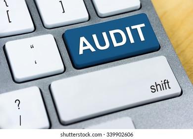Written word Audit on blue keyboard button