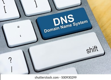 Written word DNS Domain Name System on blue keyboard button. Internet Protocol Concept
