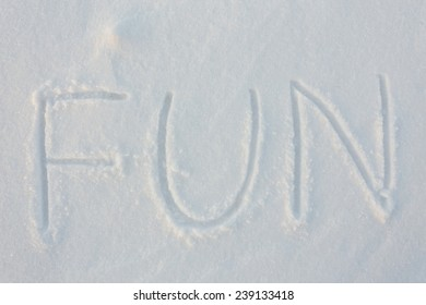 written the word fun in the snow background