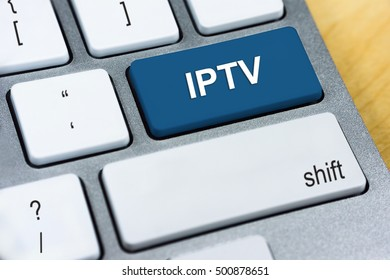 Written word IPTV abbreviation for Internet Protocol Television on blue keyboard button. Internet Protocol Concept