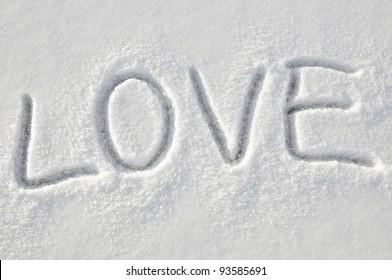 Written word love on a snow white field