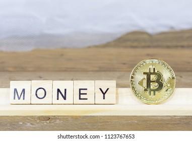 Written word money with a Bitcoin coin