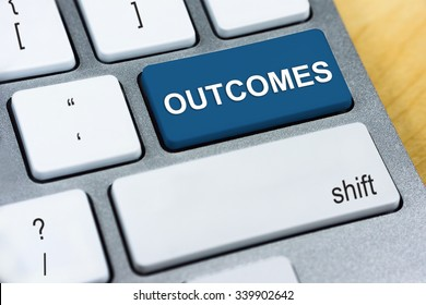 Written word Outcomes on blue keyboard button