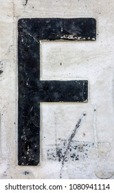 Written Wording in Distressed State Typography Found Letter F