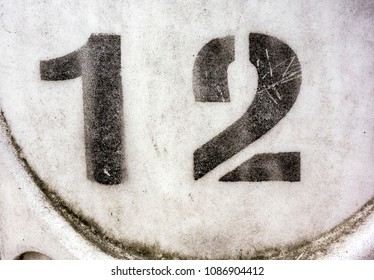 Written Wording in Distressed State Typography Found Number Twelve 12
