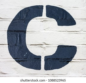 Written Wording in Distressed State Typography Found Letter C