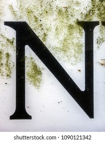 Written Wording in Distressed State Typography Found Letter N