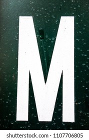 Written Wording in Distressed State Typography Found Letter M