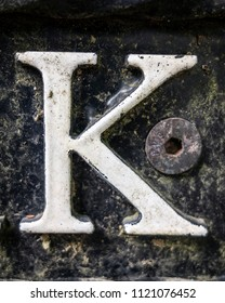 Written Wording in Distressed State Typography Found Letter K
