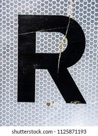 Written Wording in Distressed State Typography Found Letter R
