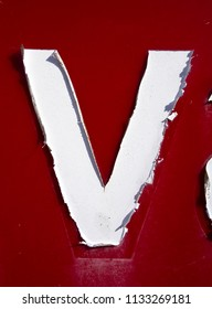 Written Wording in Distressed State Typography Found Letter V