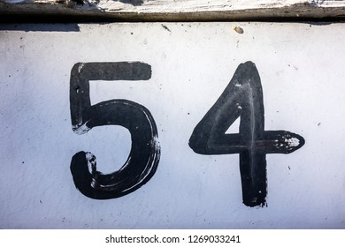 Written Wording in Distressed State Typography Found Number Fifty Four 54