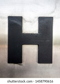 Written Wording in Distressed State Typography Found Letter H