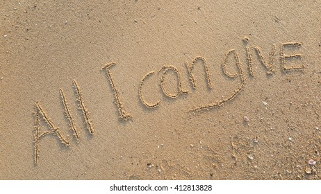 "written words ""All I can give"" on sand of beach"