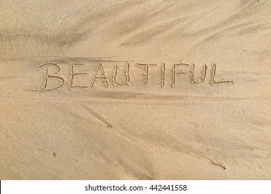"written words ""BEAUTIFUL"" on sand of beach"